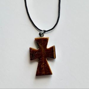 Polished stone cross on black cord necklace